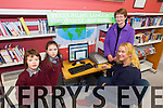 Margaret Donovan O'Keeffe and her six year twins Edward and Genevieve O'Keeffe being shown by Patti Ann O'Leary how to access the 80 languages available online at Listowel library.