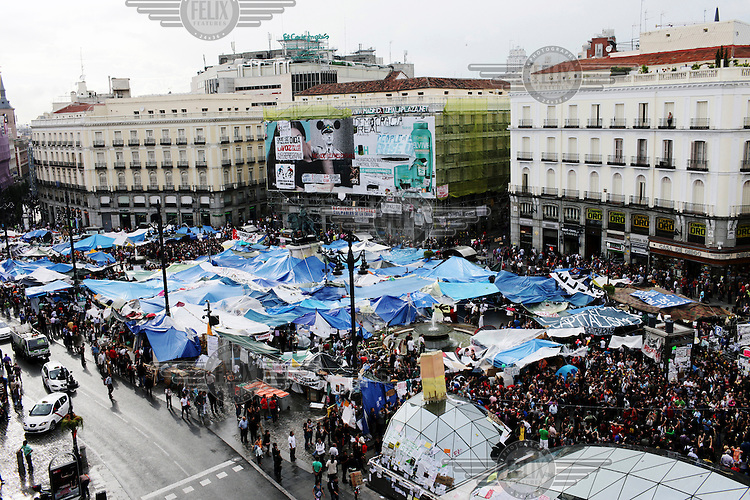 A mass rally and the protest camp in Puerta del Sol square during an ongoing demonstration against cuts and unemployment in Spain. In May 2012, following a  worsening financial crisis and a deepening recession in Spain, thousands of people started to gather in Spanish cities to protest against austerity, the global financial system, high unemplyment rate (Spain's is the highest rate in Europe) and the lack of opportunities. The protest movement has become known as 'los indignados' (the indignant ones).