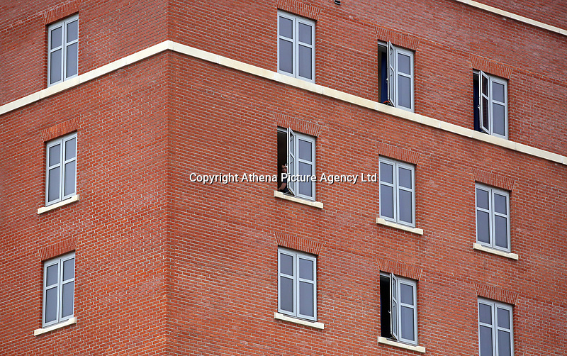 Pictured: A lone student watches the arrival of VIPs from his window at Swansea University Bay Campus. Saturday 14 October 2017<br /> Re: Hillary Clinton, the former US secretary of state and 2016 American presidential candidate will be presented with an honorary doctorate during a ceremony at Swansea University's Bay Campus in Wales, UK, to recognise her commitment to promoting the rights of families and children around the world.<br /> Mrs Clinton's great grandparents were from south Wales.