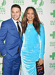LOS ANGELES, CA - FEBRUARY 22: Actors Ryan Guzman (L) and Garcelle Beauvais arrive at the 14th Annual Global Green Pre-Oscar Gala at TAO Hollywood on February 22, 2017 in Los Angeles, California.