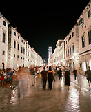 CROATIA, Dubrovnik, Dalmatian Coast, Island, blurred people walking on street at night in the old city of Dubrovnik.