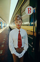 A Stewardess waiting for passengers to board the westbound Marco Polo Express.