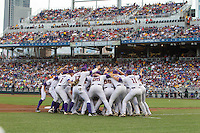 The LSU Tigers prepare to take the field prior to Game 4 of the 2013 Men's College World Series between the LSU Tigers and UCLA Bruins at TD Ameritrade Park on June 16, 2013 in Omaha, Nebraska. The Bruins defeated the Tigers 2-1. (Brace Hemmelgarn/Four Seam Images)
