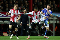 Ezri Konsa of Brentford shields the ball from Birmingham's Lukas Jutkiewicz during Brentford vs Birmingham City, Sky Bet EFL Championship Football at Griffin Park on 2nd October 2018