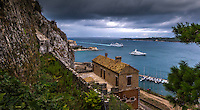 Fine Art Landscape Photograph of ships passing through the mountains in Corfu Greece.