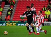 2nd December 2017, bet365 Stadium, Stoke-on-Trent, England; EPL Premier League football, Stoke City versus Swansea City;  Xherdan Shaqiri of Stoke City challenges Ki Sung-Yueng of Swansea City