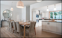 BNPS.co.uk (01202 558833)<br /> Pic: RanaKnight/BNPS.co.uk<br /> <br /> ***Must Use Full Byline***<br /> <br /> A humble holiday home a family bought for just &pound;1,000 almost a century ago on the exclusive enclave of Sandbanks has turned into a luxury property now worth &pound;5 million.<br /> <br /> The bungalow was bought new by Dr Edward Andreae in the 1920s when the practice of building on the sandy Dorset peninsula was questioned because of perceived issues over stability.<br /> <br /> Over the last seven decades the bolthole has been passed down through the generations of the same family until it fell into a state if disrepair.<br /> <br /> In 2011 Dr Andreae's great-grandson, Tim Baldwin, and his father Jonathan, made the drastic decision to demolish the 90 year old building and erect a new one in its place.<br /> <br /> They spent 580,000 pounds creating a luxurious beach escape on the 'Millionaires' Row' in Poole Harbour.<br /> <br /> The plot is now home to a sprawling seven bedroom, five bathroom property which experts believe to be worth around five million pounds - 5,000 times it's original purchase price.