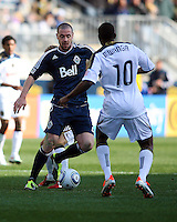 Danny Mwanga#10 of the Philadelphia Unionmoves in on Eric Hassli#29 of the Vancouver Whitecaps during an MLS match at PPL Park in Chester, PA. on March 26 2011. Union won 1-0.