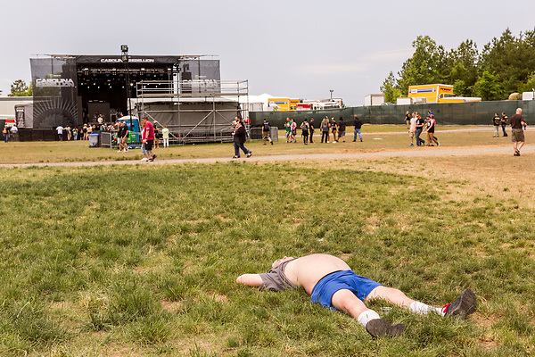 May 7, 2016. Concord, North Carolina. <br />  A fan napping.<br />  The 2016 Carolina Rebellion was held over May 6-8 next to the Charlotte Motor Speedway and featured over 50 bands including headliners Lynyrd Skynyrd, The Scorpions, Five Finger Death Punch, Disturbed, and Rob Zombie.