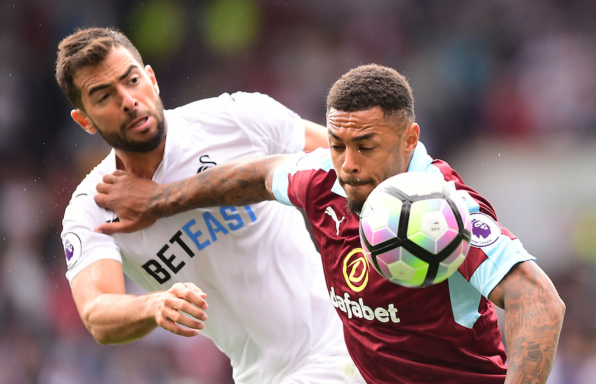 Burnley's Andre Gray vies for possession with Swansea City's Jordi Amat<br /> <br /> Photographer Chris Vaughan/CameraSport<br /> <br /> Football - The Premier League - Burnley v Swansea City - Saturday 13th August 2016 - Turf Moor - Burnley<br /> <br /> World Copyright &copy; 2016 CameraSport. All rights reserved. 43 Linden Ave. Countesthorpe. Leicester. England. LE8 5PG - Tel: +44 (0) 116 277 4147 - admin@camerasport.com - www.camerasport.com