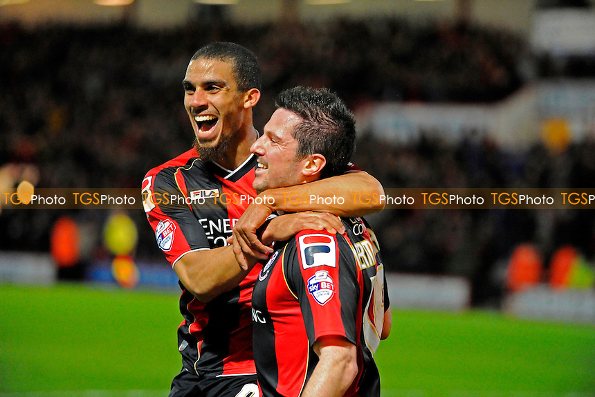Lewis Grabban of AFC Bournemouth and Yann Kermorgant of AFC Bournemouth celebrate - AFC Bournemouth vs Reading - Sky Bet Championship Football at the Goldsands Stadium, Bournemouth, Dorset - 08/04/14 - MANDATORY CREDIT: Denis Murphy/TGSPHOTO - Self billing applies where appropriate - 0845 094 6026 - contact@tgsphoto.co.uk - NO UNPAID USE