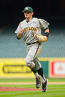 First baseman Max Muncy #9 of the Baylor Bears runs off the field at the end of an inning against the Houston Cougars at Minute Maid Park on March 4, 2011 in Houston, Texas.  Photo by Brian Westerholt / Four Seam Images