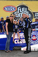 Apr. 3, 2011; Las Vegas, NV, USA: NHRA funny car driver Robert Hight (right) celebrates with wife Adria Hight and daughter Autumn Hight after winning the Summitracing.com Nationals at The Strip in Las Vegas. Mandatory Credit: Mark J. Rebilas-