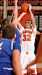 SIOUX FALLS, SD - JANUARY 10:  Taylor Lupton #32 from Washington spots up for a jumper against O'Gorman in the second quarter Tuesday night at Washington.(Photo by Dave Eggen/Inertia)