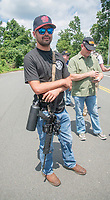Fairfax,VA August 4 2018, USA: A pro gun supporters carries his unarrmed assualt style gun as  demonstrators on both sides of the gun control issue rally at the National headquarters of the National Rifle Association (NRA) in Fairfax, VA.  Dubbed  &quot;The March on the NRA&quot; protestors line the streets in fron the of headquarters.  DC.  <br /> CAP/MPI/PYL<br /> &copy;PYL/MPI/Capital Pictures