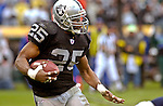 Oakland Raiders running back Charlie Garner (25) on Sunday, November 30, 2003, in Oakland, California. The Broncos defeated the Raiders 22-8.