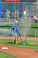 The grounds crew works to prepare the field as the safety fences are rolled off when the Ogden Raptors faced the Orem Owlz at Lindquist Field on August 28, 2013 in Ogden Utah.  (Stephen Smith/Four Seam Images)