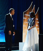 United States President Barack Obama and first lady Michelle Obama arrive on stage for the Congressional Black Caucus Foundation Annual Phoenix Awards dinner at the Walter E. Washington Convention Center, September 27, 2014 in Washington, DC. The CBC's annual conference brings together activists, politicians and business leaders to discuss public policy impacting Black communities in America and abroad. <br /> Credit: Olivier Douliery / Pool via CNP
