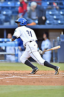 Asheville Tourists center fielder Shael Mendoza (21) swings at a pitch during a game against the Rome Braves at McCormick Field on April 17, 2018 in Asheville, North Carolina. The Tourists defeated the Braves 1-0. (Tony Farlow/Four Seam Images)
