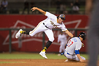 AFL West shortstop Cole Tucker (2), of the Surprise Saguaros and the Pittsburgh Pirates organization, applies the tag to Nico Hoerner (17) as he slides into second base on a stolen base attempt during the Fall Stars game at Surprise Stadium on November 3, 2018 in Surprise, Arizona. The AFL West defeated the AFL East 7-6 . (Zachary Lucy/Four Seam Images)