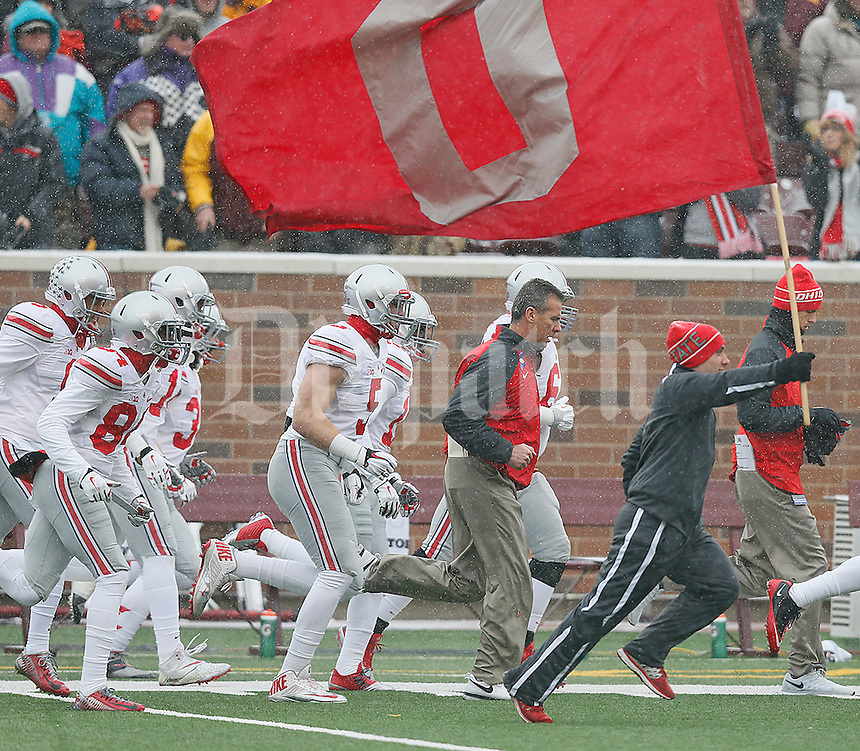 Urban Meyer and the Buckeyes take the field prior to the start of their game against the Minnesota Gophers at TCF Bank Stadium on November 15, 2014. (Chris Russell/Dispatch Photo)