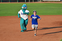 Oggie the Ogden Raptors mascot races a fan during the game against the Great Falls Voyagers in Pioneer League action at Lindquist Field on July 18, 2014 in Ogden, Utah.  (Stephen Smith/Four Seam Images)