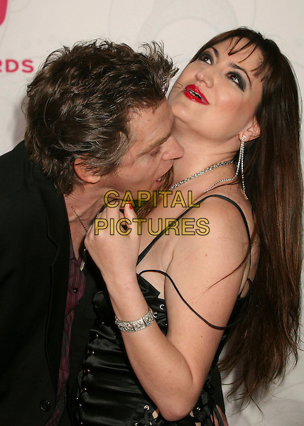 JEFF CONAWAY & GUEST.5th Annual TV Land Awards at Barker Hangar, Santa Monica, California, USA, 14 April 2007..half length kissing neck.CAP/ADM/BP.©Byron Purvis/AdMedia/Capital Pictures.