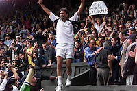WIMBLEDON CHAMPIONSHIPS 2001 09/07/01 MENS FINAL GORAN IVANISEVIC (CROATIA) V PAT RAFTER GORAN IVANISEVIC LEAPS INTO THE CROWD TO VISIT HIS FATHER AND TEAM PHOTO ROGER PARKER