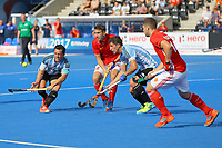 Pedro Ibarra and Ignacio Ortiz of Argentina compete with Mark Gleghorne and David Condon of England to win the ball in the Argentine D during the Hockey World League Semi-Final match between England and Argentina at the Olympic Park, London, England on 18 June 2017. Photo by Steve McCarthy.