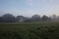 The garden front of Burtown glimpsed through the early morning mist