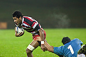 Sikeli Nabou manages to evade the tackle of Justin Davies. Counties Manuaku Steelers vs Northland pre-season Air New Zealand NPC rugby game played at Bayer Growers Stadium Pukekohe on July 24th 2009..Northland won 10 - 3.