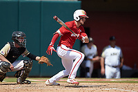 Brock Deatherage (13) of the North Carolina State Wolfpack follows through on his swing against the Army Black Knights at Doak Field at Dail Park on June 3, 2018 in Raleigh, North Carolina. The Wolfpack defeated the Black Knights 11-1. (Brian Westerholt/Four Seam Images)
