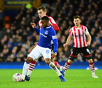 Everton's Ademola Lookman shields the ball from Lincoln City's Harry Toffolo<br /> <br /> Photographer Andrew Vaughan/CameraSport<br /> <br /> Emirates FA Cup Third Round - Everton v Lincoln City - Saturday 5th January 2019 - Goodison Park - Liverpool<br />  <br /> World Copyright &copy; 2019 CameraSport. All rights reserved. 43 Linden Ave. Countesthorpe. Leicester. England. LE8 5PG - Tel: +44 (0) 116 277 4147 - admin@camerasport.com - www.camerasport.com