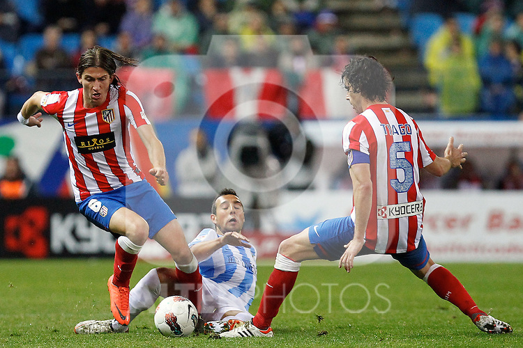 Atletico de Madrid's Filipe Luis, Tiago (r) and Malaga's Santiago Cazorla (c) during La Liga match. Mayo 5,2012. (ALTERPHOTOS/Arnedo & Alconada)