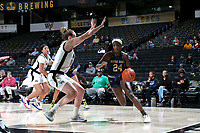 WINSTON-SALEM, NC - FEBRUARY 06: Destinee Walker #24 of the University of Notre Dame drives past Alex Sharp #14 of Wake Forest University during a game between Notre Dame and Wake Forest at Lawrence Joel Veterans Memorial Coliseum on February 06, 2020 in Winston-Salem, North Carolina.