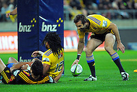 Conrad Smith congratulates Ma'a Nonu on his try during the Super Rugby match between the Hurricanes and Chiefs at Westpac Stadium, Wellington, New Zealand on Saturday, 16 May 2015. Photo: Dave Lintott / lintottphoto.co.nz