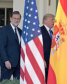 United States President Donald J. Trump, right, and President of the Government or Prime Minister Mariano Rajoy of Spain, left, walk on the Colonnade prior to conducting a joint press conference in the Rose Garden of the White House in Washington, DC on Tuesday, September 26, 2017.<br /> Credit: Ron Sachs / CNP