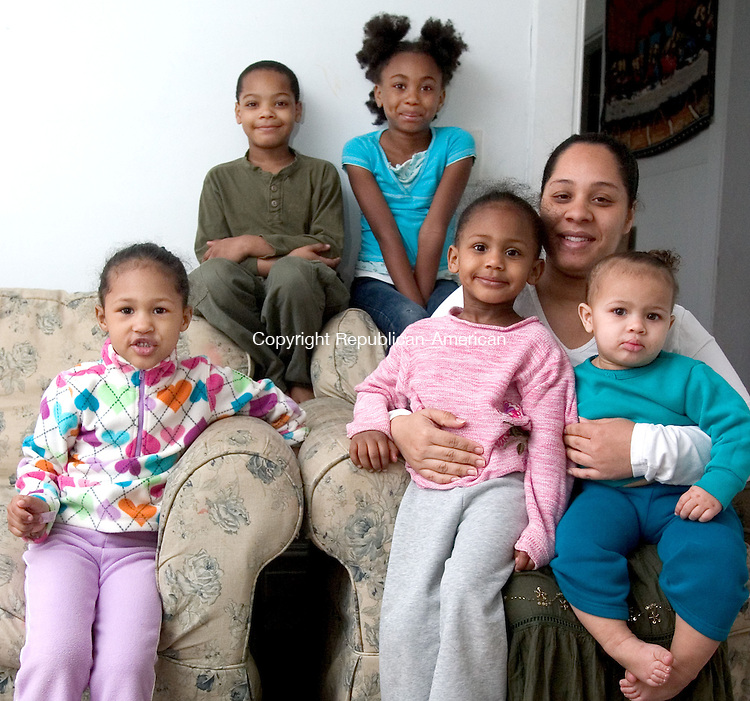 WATERBURY, CT. 13 April 2010-041310SV10--Emily Becker sits with her four children. They are Neftali McNeil, Jasmine Becker, 5, Michelle Becker, 3, and  Reniza Becker,1 at their home in Waterbury. Members of The Salvation Army in Waterbury are working with the needy family to get them housing and then paint the children's rooms. Also in Photo (? see Tracy O&rsquo;Shaughnessy &ndash; she is getting name)<br /> Steven Valenti Republican-American