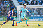 Ivan Rakitic (r) of FC Barcelona is followed by Alexander Szymanowski of CD Leganes during the La Liga 2017-18 match between CD Leganes vs FC Barcelona at Estadio Municipal Butarque on November 18 2017 in Leganes, Spain. Photo by Diego Gonzalez / Power Sport Images
