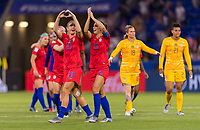LYON,  - JULY 2: Alex Morgan #13 and Allie Long #20 salute the crowd during a game between England and USWNT at Stade de Lyon on July 2, 2019 in Lyon, France.