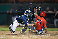 Angel Molina (33) of the Orem Owlz is tagged out at hoe plate by Helena Brewers catcher Alexandre Guenette (38) as umpire Colin Baron looks on at Kindrick Legion Field on August 17, 2017 in Helena, Montana.  The Owlz defeated the Brewers 5-2.  (Brian Westerholt/Four Seam Images)