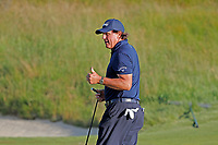 Phil Mickelson (USA) reacts after making a putt on the 18th green during the second round of the 118th U.S. Open Championship at Shinnecock Hills Golf Club in Southampton, NY, USA. 15th June 2018.<br /> Picture: Golffile | Brian Spurlock<br /> <br /> <br /> All photo usage must carry mandatory copyright credit (&copy; Golffile | Brian Spurlock)