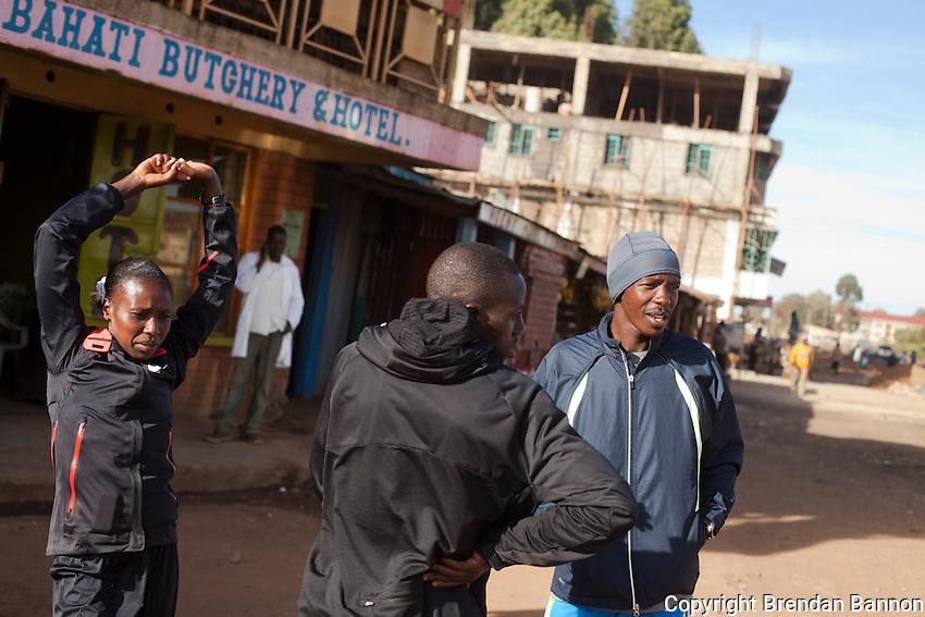 Elite Kenya woman marathon runner Florence Kiplagat and her pace-setters Simon Kosgei and Shadrack Maiyo before  a training run outside Eldoret, Kenya.