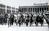 BNPS.co.uk (01202 558833)<br /> Pic: Dickins/BNPS<br /> <br /> Hitler leading the celebration's at the huge Nazi victory parade for the Condor Legion in the heart of Berlin in June 1939. Richtofhen marches next to his Luftwaffe boss Goering.<br /> <br /> The unseen personal photo album of Field Marshal Wolfram von Richthofen, cousin to the legendary Red Baron, which gives an unprecedented insight into his military career in the Third Reich, has been rediscovered.<br /> <br /> Wolfram served in the Red Baron's squadron in the WW1, went on to design the 'Jericho trumpet' of the infamous Stuka Bomber between the wars, before leading the Condor Legion in the Spanish Civil War.<br /> <br /> After the outbreak of WW2 the fascinating album shows Richthofen's lead roll in Operation Barbarossa - the Nazi's suprise invasion of Communist Russia and their race to conquer the vast country before the onset of the notorious Russian winter.<br /> <br /> The two albums were taken from Berlin by a British soldier at the end of the Second World War who kept it for 60 years before it was passed into the hands of a private collector.<br /> <br /> Dickins auctions are selling the historic albums with a &pound;20,000 estimate on 31st March.
