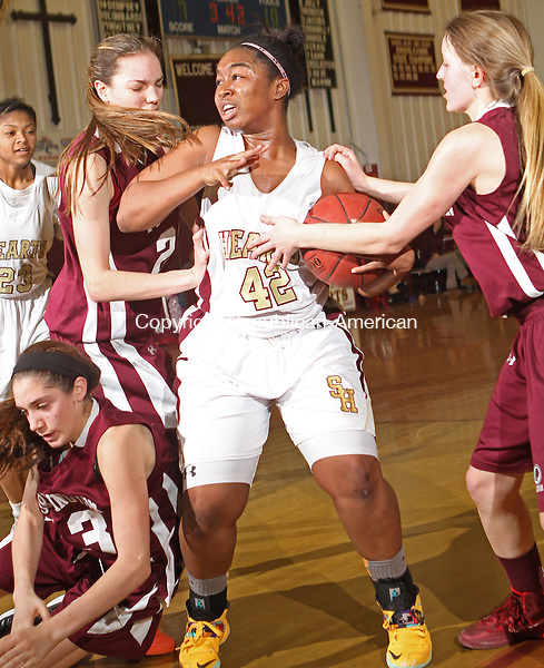 WATERBURY, CT-25 January 012514MK10 Sacred Heart's Maya Eggleston (42) battles through Torrington's Brie Pergola (13) Mika Howard (22) and Caroline Teti (15) on her way to the hoop during NVL girl's basketball action Saturday evening at Sacred Heart High School.  Sacred Heart defeated Torrington 50-42. Michael Kabelka / Republican-American