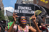 NEW YORK, NY - JUNE 28: A person holds a sign during the Queer March for Black Lives on June 28, 2020 in New York City. LGBTQ  community are celebrating the 51st anniversary of the Stonewall Riots.(Photo by Joana Toro /VIEWpress)