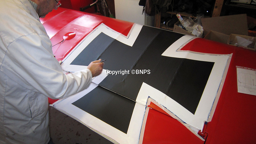 BNPS.co.uk (01202 558833)<br /> Pic: PhilYeomans/BNPS<br /> <br /> Cross of Iron - the WW1 German cross is painted on the 'Ricthofen red' fabric.<br /> <br /> Dreaded Red Baron to fly again...WW1 Ace's feared 'Fokker Dreidecker' to finally fly over Britain.<br /> <br /> A German GP based in Norfolk has spent 8 years building a Fokker triplane in his garage as a tribute to infamous WW1 Ace Manfred von Ricthofen, who terrorised the skies over the Western front during the first war.<br /> <br /> Dr Peter Brueggemann, 52, will fulfil his childhood dream and emulate the notorious German fighter pilot when the Dreidecker Dr.1 fighter finally achieves lift-off this summer.<br /> <br /> Dr Brueggemann has even acquired the title Baron from the independent territory of Sealand so he can take to the skies as Baron Peter von Brueggemann in homage to his idol.<br /> <br /> The GP at the Holt Medical Practice in Norfolk hopes to be airborne in a few months once tests on the engine are completed at Felthorpe airfield near Norwich where he has devoted thousands of hours to the project.<br /> <br /> The father-of-two, who has lived in England with wife Sue for 20 years, has been taking flying lessons since his project began.