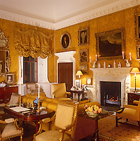 The walls of the impressive drawing room at Nostell Priory are covered in a deep gold damask, with matching festoons hanging from gilded pelmets