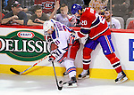 23 January 2010: Montreal Canadiens' defenseman Ryan O'Byrne struggles for the puck against New York Rangers left wing forward and former Canadien Christopher Higgins at the Bell Centre in Montreal, Quebec, Canada. The Canadiens shut out the Rangers 6-0. Mandatory Credit: Ed Wolfstein Photo