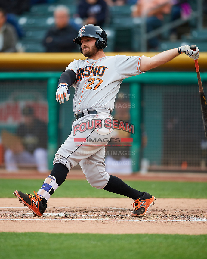 Tyler White (27) of the Fresno Grizzlies follows through on his swing against the Salt Lake Bees during the Pacific Coast League game at Smith's Ballpark on April 17, 2017 in Salt Lake City, Utah. The Bees defeated the Grizzlies 6-2. (Stephen Smith/Four Seam Images)